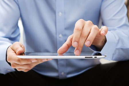 portable information device: Young adult working on a digital tablet