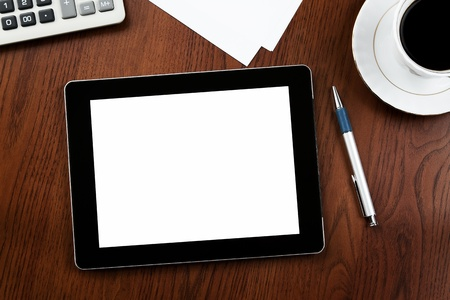 Blank digital tablet at the desk with clipping path for the screen