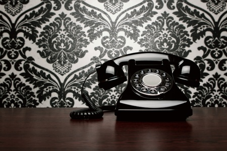 rotary dial telephone: Vintage telephone at the desk