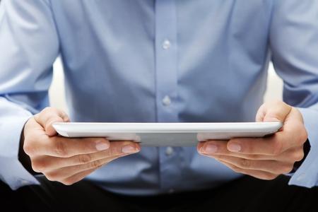 reading news: Reading news at digital tablet Stock Photo
