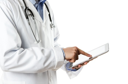 specialists: Doctor working on a digital tablet Stock Photo