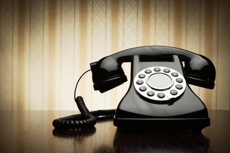 Vintage telephone over striped wallpaper photo