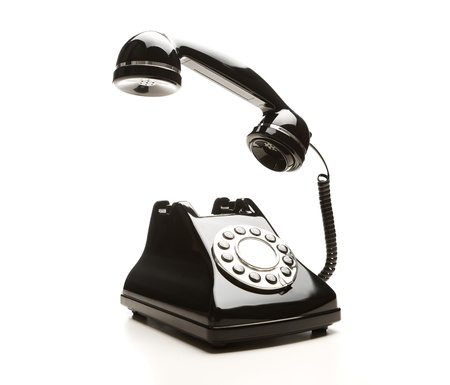 antique phone: Retro telephone on white background Stock Photo