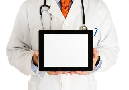 tablet pc in hand: Doctor holding blank digital tablet with clipping path for the screen Stock Photo