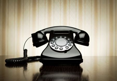 rotary phone: Vintage telephone over striped wallpaper