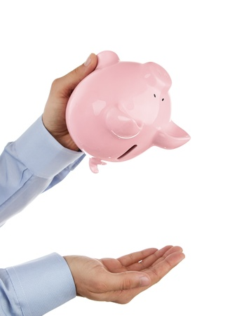 upside down: Shaking out empty piggy bank Stock Photo