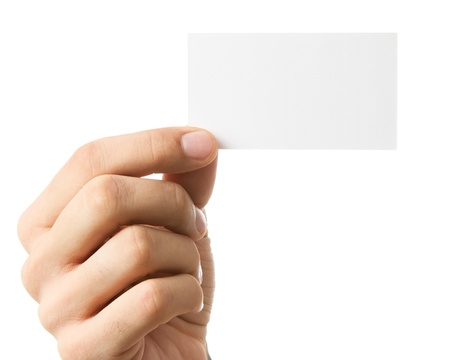 hand with card: Close up of human hand holding business card isolated Stock Photo