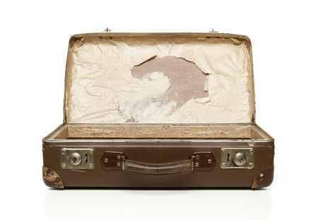 Grunge opened suitcase isolated on white background photo