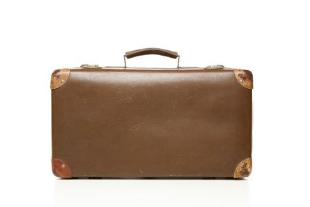 Vintage leather suitcase isolated on white photo