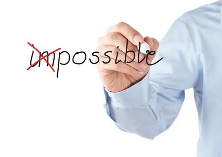 Motivation concept, transforming word impossible into possible photo