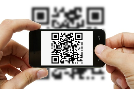 Scanning QR code with mobile phone Stock Photo