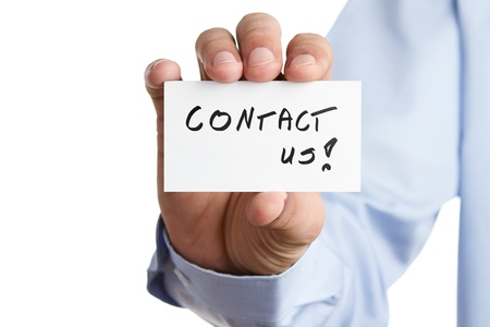 advertise with us: Human hand holding business card with contact us text Stock Photo