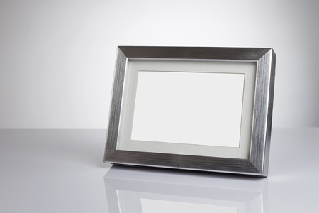 picture frame on wall: Blank silver picture frame at the desk with clipping path Stock Photo