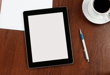 Blank digital tablet on a desk with clipping path for the screen photo