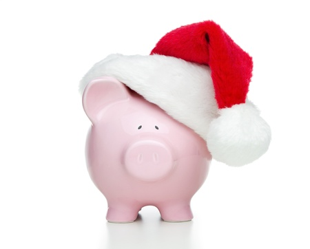 christmas savings: Piggy bank with santa hat