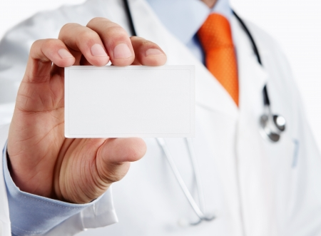 holding business card: Doctor holding blank business card with copy space Stock Photo