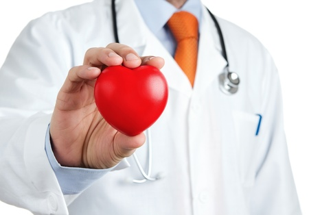 medical heart: Red rubber heart in doctors hand