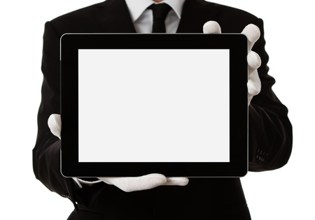 waiters: Elegant man presenting product or text on digital tablet with clipping path Stock Photo