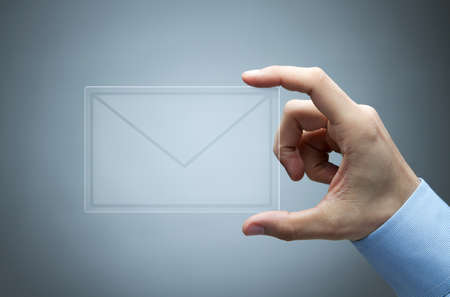 show business: Human hand holding futuristic transparent mail icon