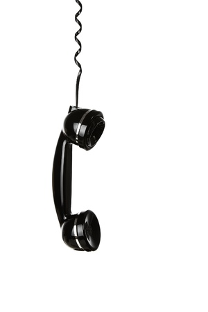 customer support: Old telephone handset hanging in the air isolated on white