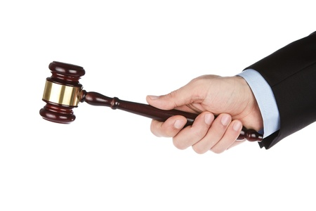 Male hand holding wooden gavel isolated on white background photo