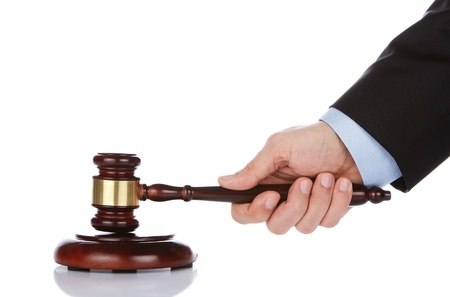 auction gavel: Human hand holding a wooden gavel Stock Photo