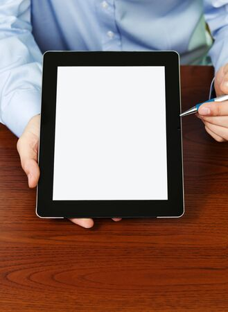 Businessman Presenting Your Text At Digital Tablet With Clipping Path For The Screen photo