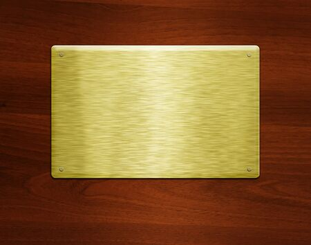 Blank golden plate at wooden background with copy space photo