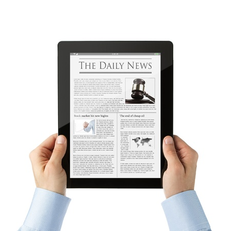 Reading business news at digital tablet photo