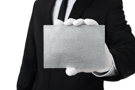 Butler showing blank silver card with copy space photo
