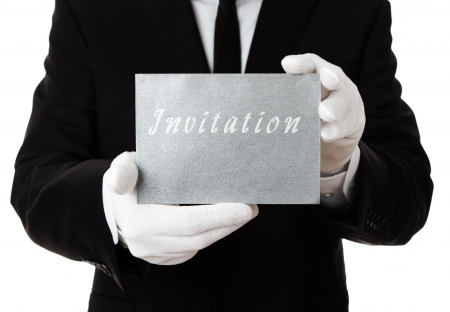 tuxedo jacket: Butler holding silver invitation card with copy space