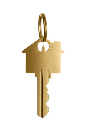 Gold house shaped key isolated on white background photo