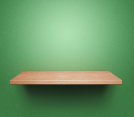 Empty wooden shelf at the green wall photo