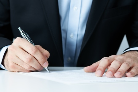 autograph: Close up of office worker filling documents