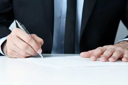 law office: Close up of human hands signing a contract