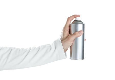 Human hand holding blank spray paint can isolated on white photo