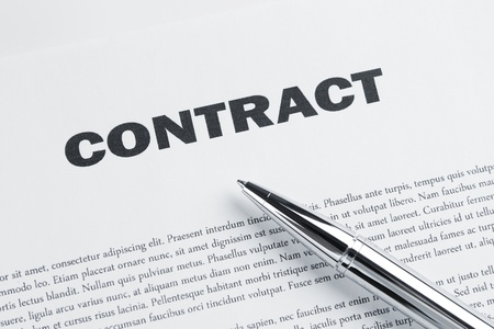 law business: Contract and pen at the desk ready to sign it Stock Photo