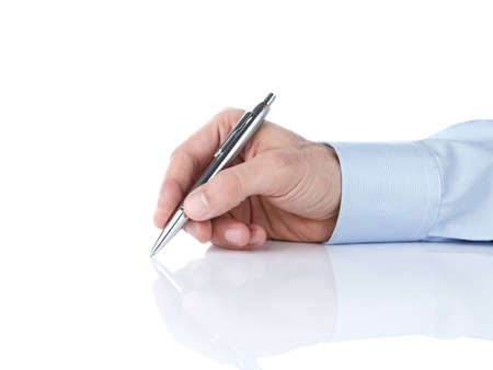 Human hand writing with silver ballpoint pen Stock Photo - 12538488