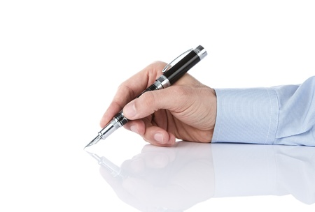 Human hand writing with pen isolated on white background photo