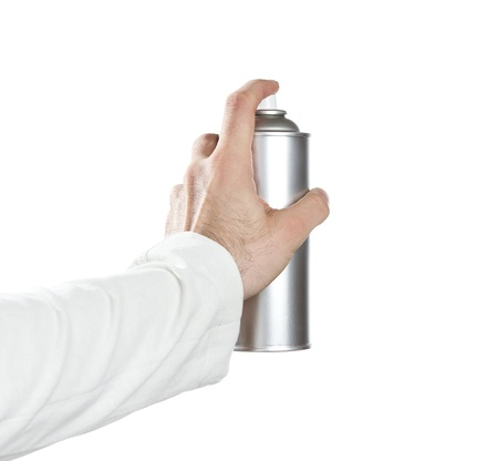Human Hand Spraying With Paint Over White Background photo