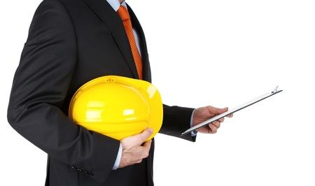 Engineer reading notes isolated on white background Stock Photo - 12538663