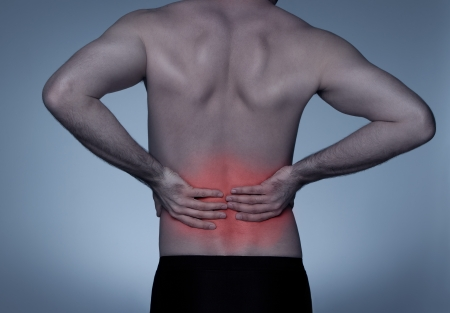 dolor de espalda: El dolor de espalda Foto de archivo