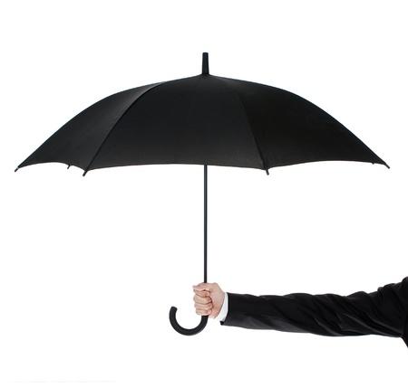 lluvia paraguas: Hombre de negocios que sostiene un paraguas sobre fondo blanco Foto de archivo
