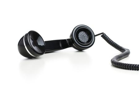 Vintage telefoonhoorn op een witte achtergrond
