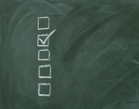 Checklist at the blackboard with copy space photo