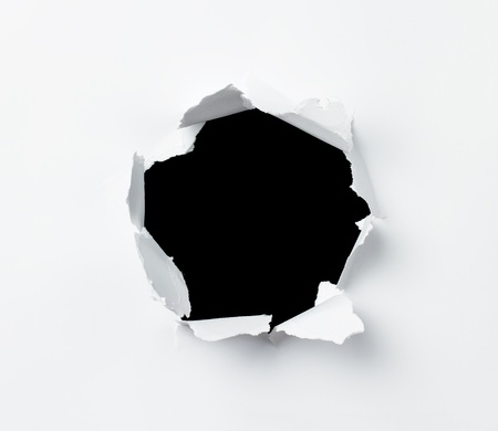 hole in wall: Hole punched in the paper sheet Stock Photo