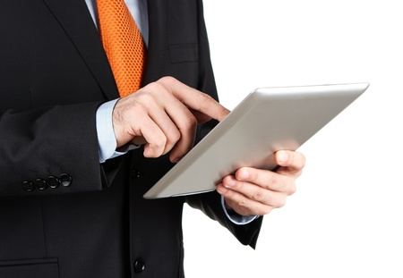 Businessman working on a digital tablet isolated on white photo