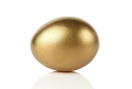 Gold egg isolated on white background photo