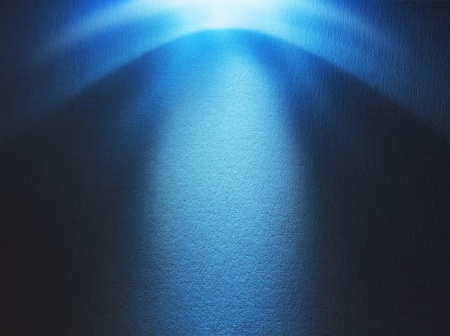 Blue light beam hitting at the rough surface with copy space photo