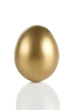 Golden egg isolated on white background
